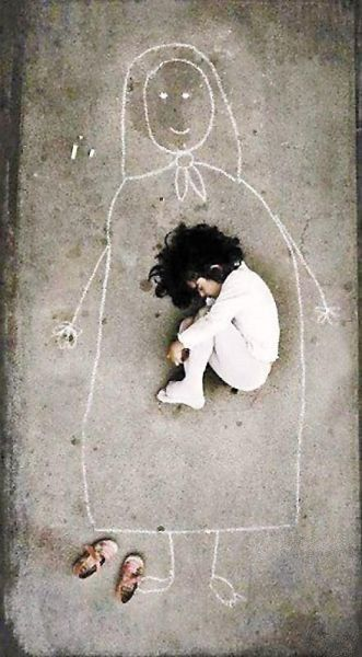 Heartbreaking image by an Iraqi artist taken in an orphanage. This little girl has never seen her mother, so she drew a mom on the ground and fell asleep with her