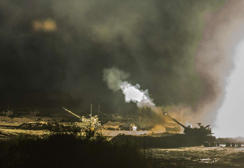 An Israeli artillery gun fires a 155mm shell towards targets in the Gaza Strip