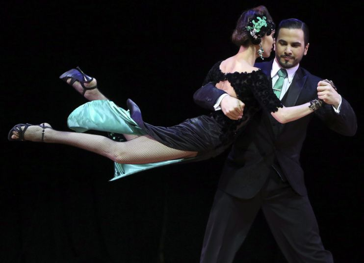 Ezequiel Jesus Lopez and Camila Alegre perform after winning the Stage Tango category final, during the Tango Dance World Cup 2015 in Buenos Aires