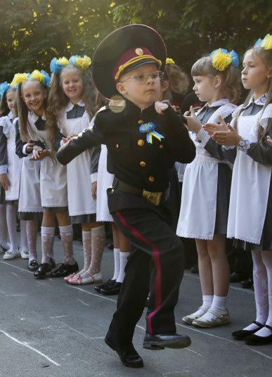 First graders at a cadet school attend a ceremony to mark the start of the new academic year in Kiev, Ukraine