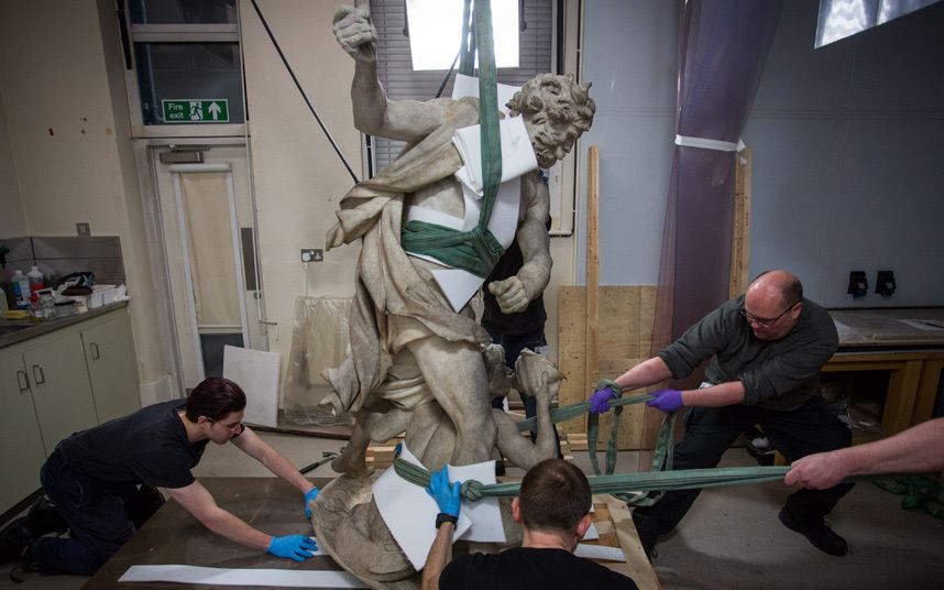 Technicians prepare to move a sculpture of Neptune & Triton at the Victoria and Albert Museum in London.