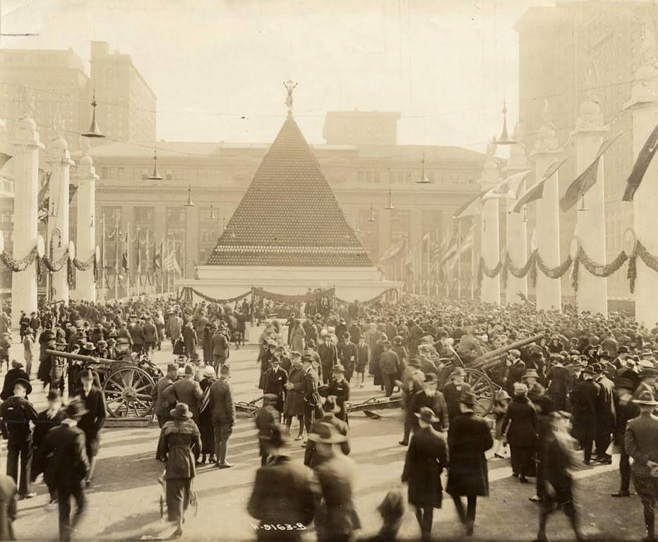 A towering pyramid of 12,000 German helmets in front of Grand Central Terminal, New York in 1918
