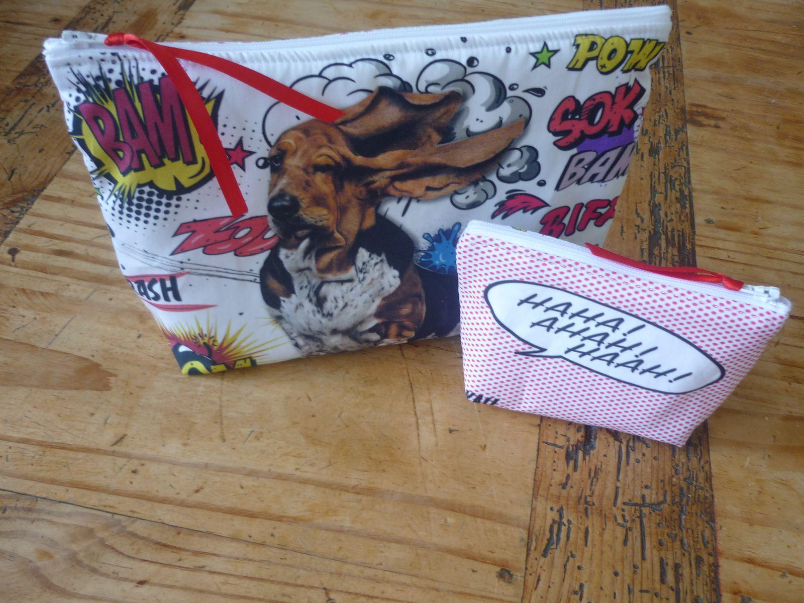 """trousse à maquillage """" piff bam boom le chien """" kali-créatrice-original Matériaux utilisés : Coton , Satin Trousse rigolote Le motif a été réalisé par mes soins et imprimé à Paris sur de la popeline. L'intérieur est doublé avec de la toile de coton blanche et entièrement ouatiné pour un meilleur maintien. Le zip est agrémenté d'un ruban de satin rouge . Dimension : 24.50 x 18 cm 5 cm de profondeur."""