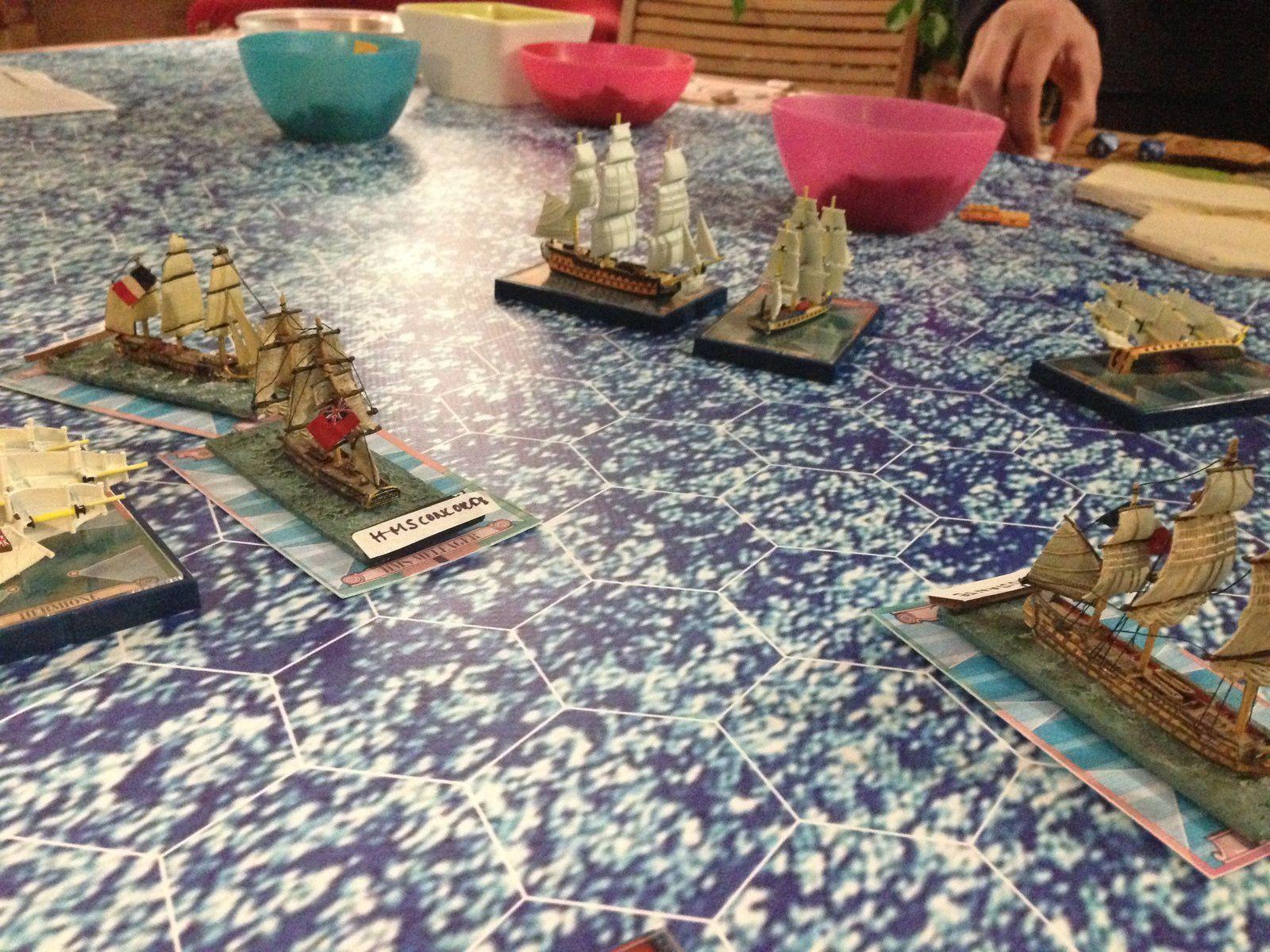 Les anglais voient une de leur frégate échouer sur le récif mais les autres réussissent à passer faisant des dégâts importants aux navires français pour aller se mettre devant le Grand Port ! Mat !