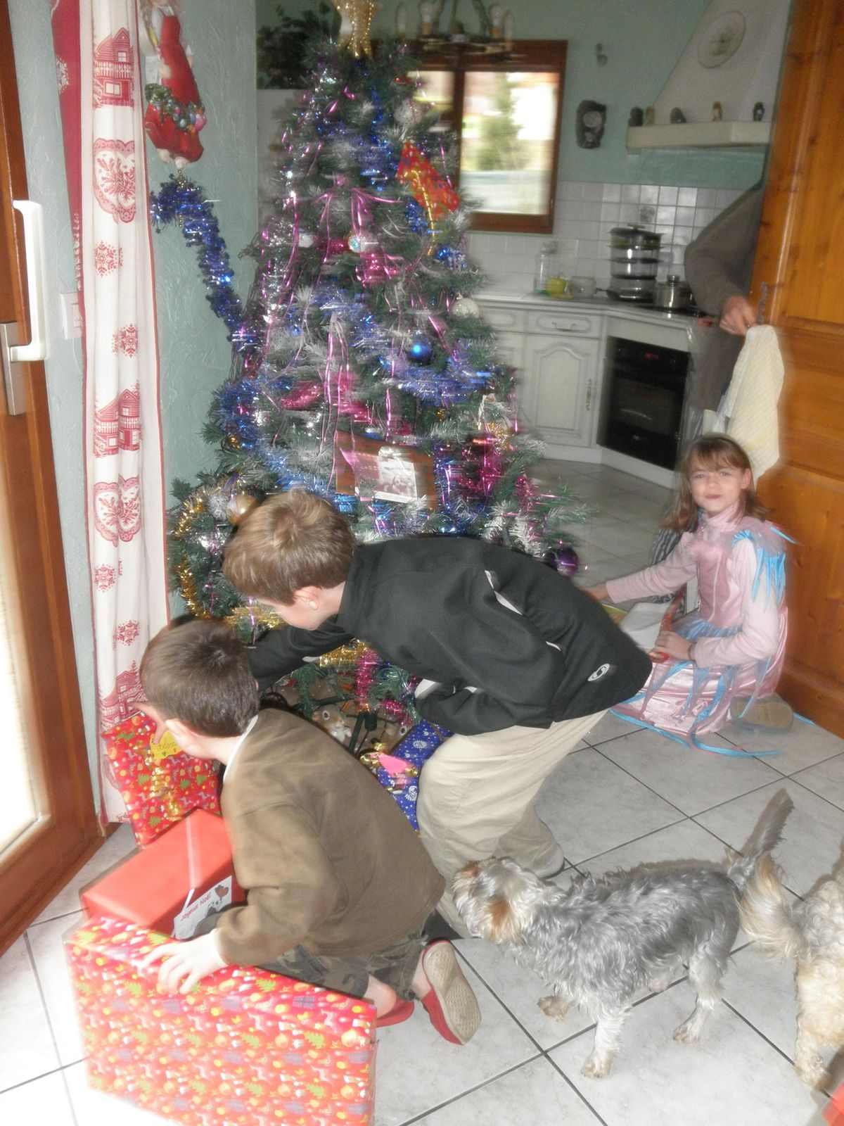 Then it's the family's turn to open the presents...