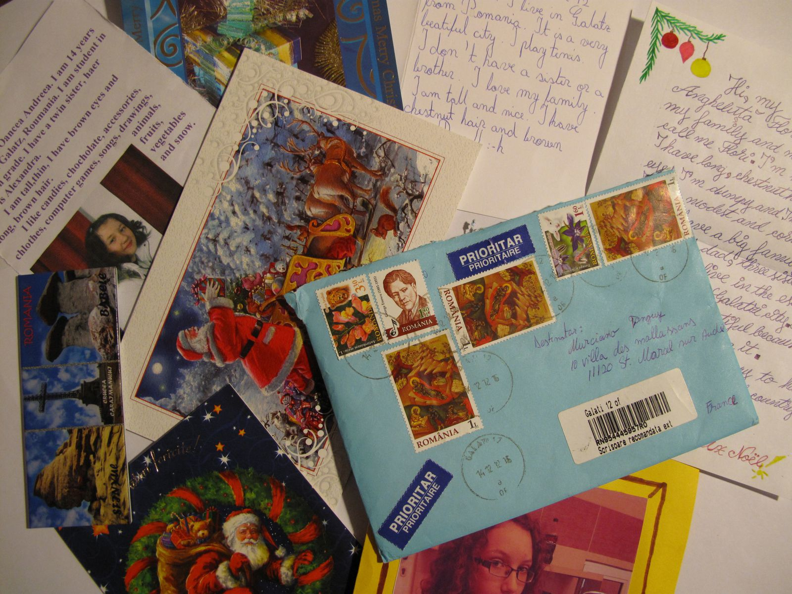 Our penpals sent us postcards and magnets at home. We sent them postcards too. We kept the envelopes because the stamps are original.