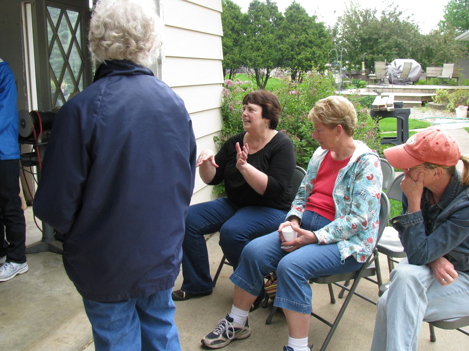 The 2012 Homegrown Lifestyle class participants toured Master Gardener Phil Pfister's yard.  The tour featured vegetable gardens, a hoop house, and other tools for season extension.
