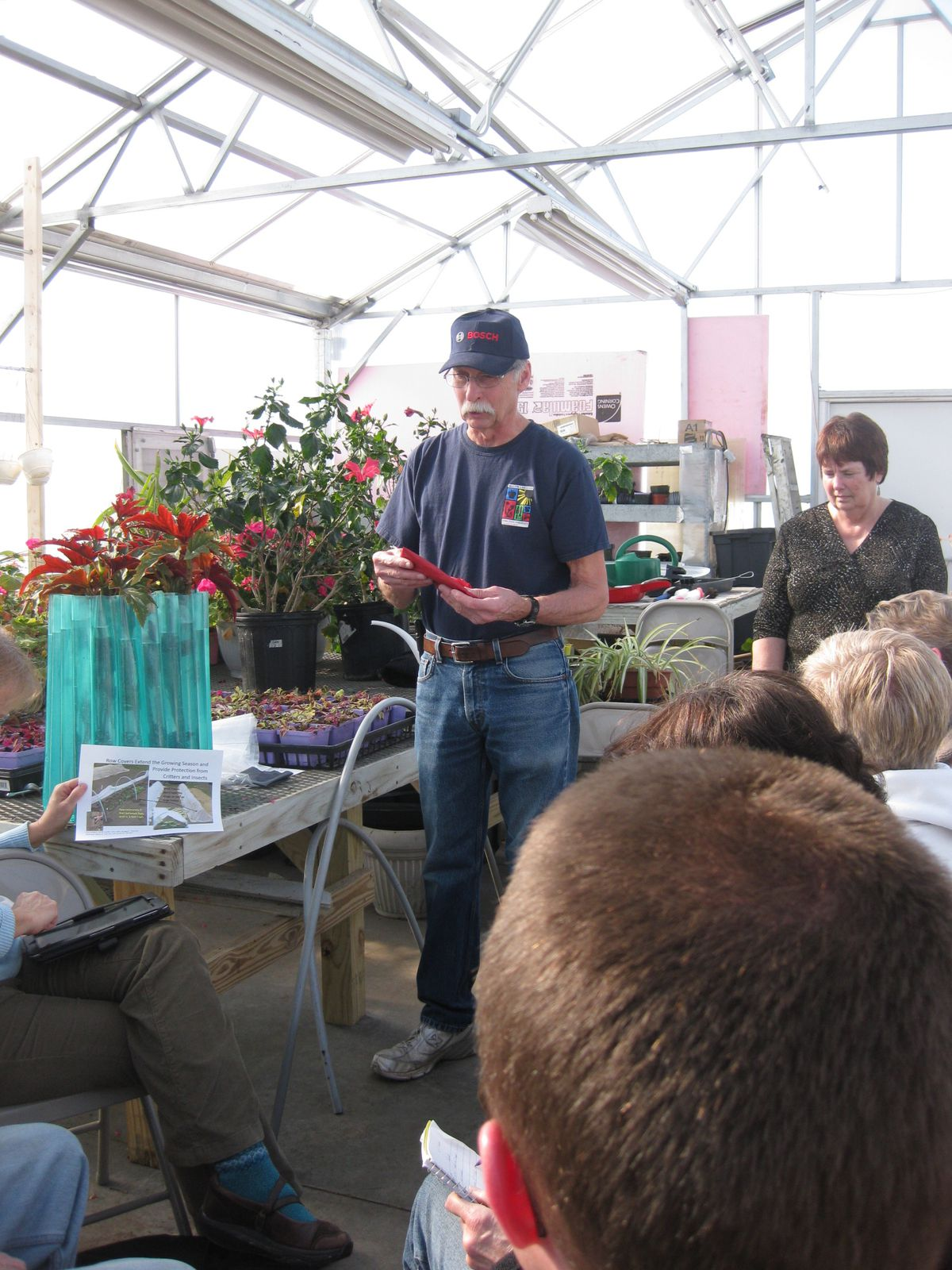 Row covers can provide many benefits to create a suitable growing environment.  Attendees also discussed organic and plastic (clear, black, and red) mulches.