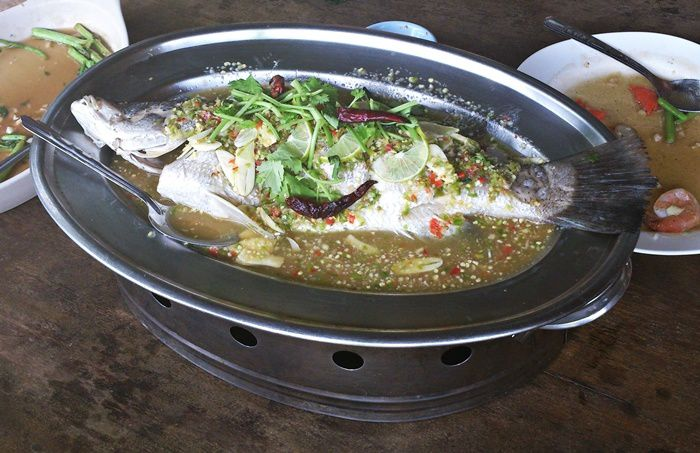 Steamed fish, with lots of hidden chili