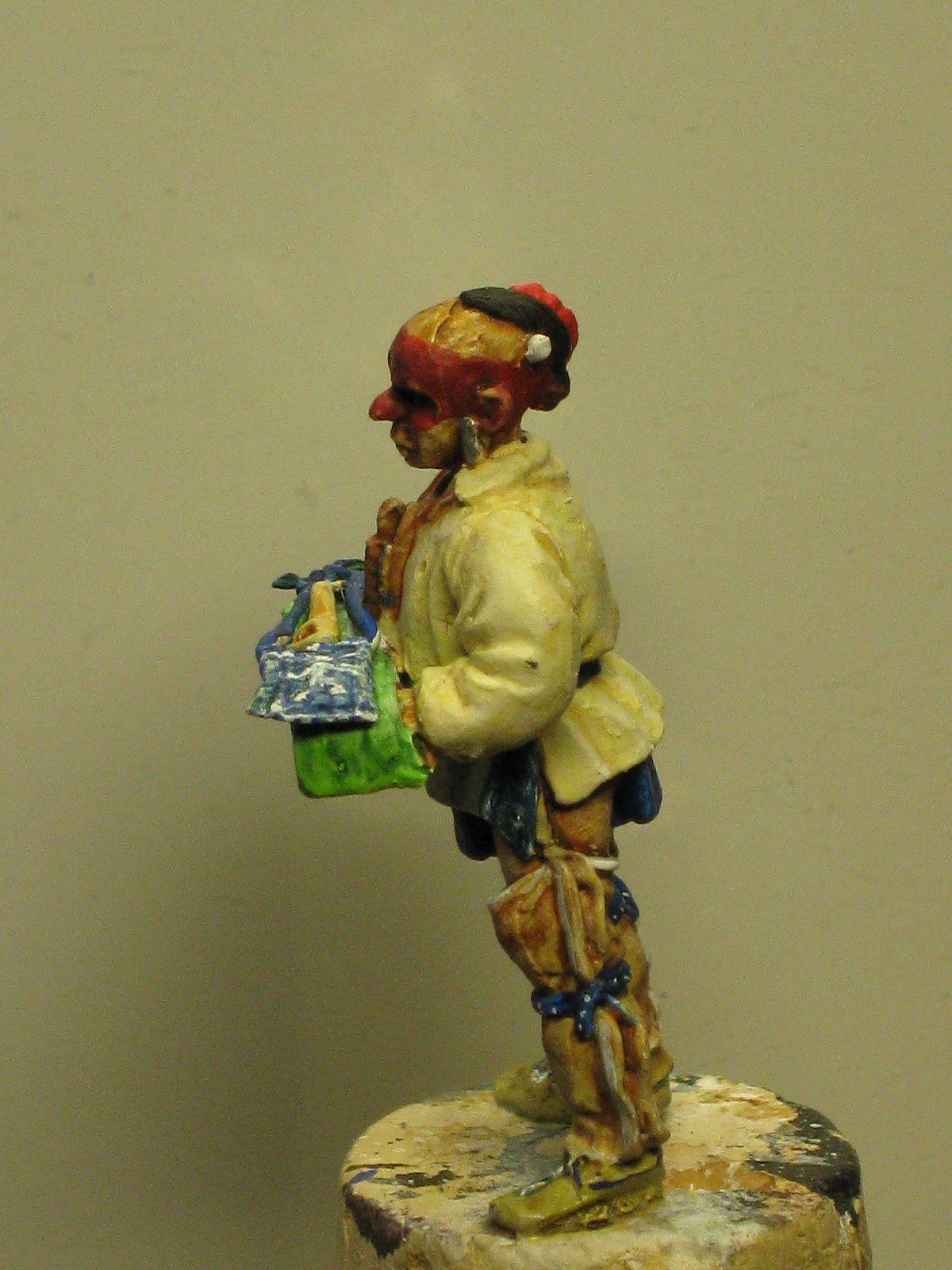Comme on peut le voir sur les figurines non peintes , le wapum est difficilement identifiable comme tel