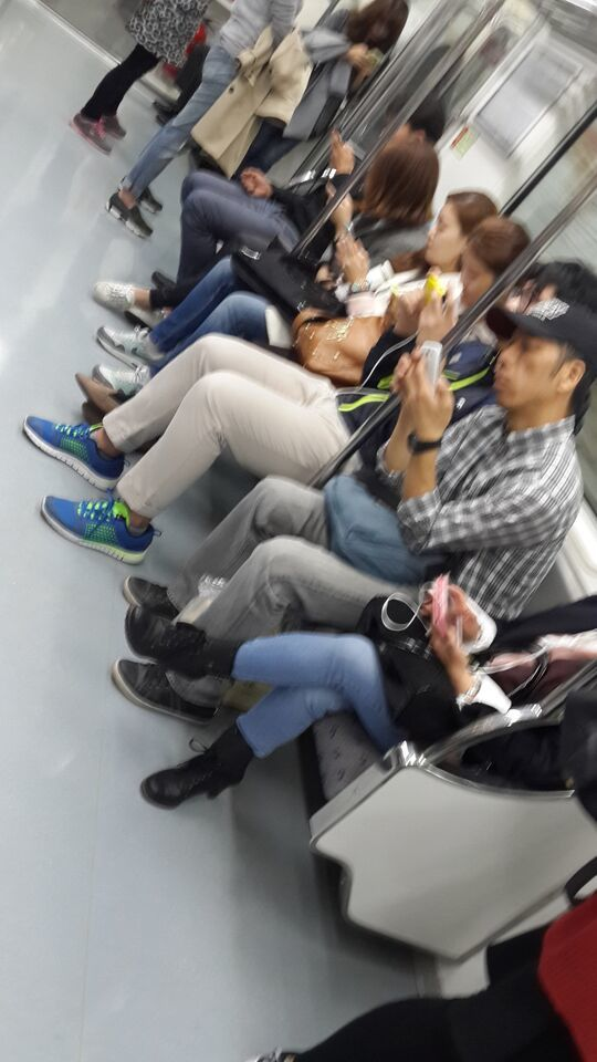 The Army of the Dead, all zombified by headphones and smartphones