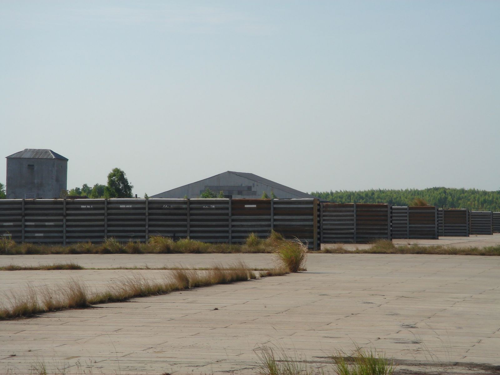 Aircraft revetment. The building to the left may be a recent construction.
