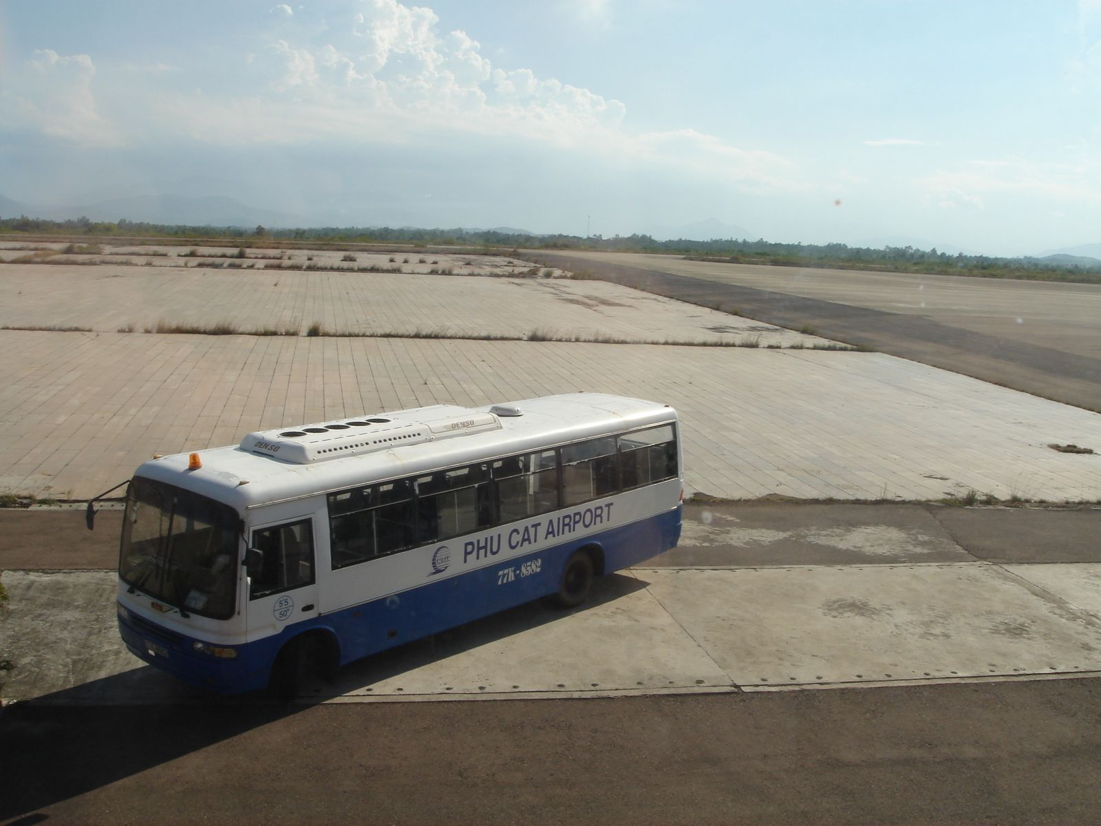 Vietnam Airlines bus, with the taxiway leading to the runway in the back.