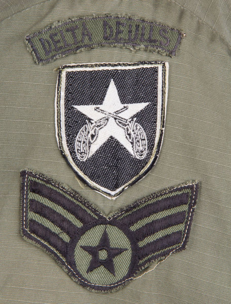 "The black and white silk embroidered patch (a construction often referred to as ""bevo"", because of similar patches produced in Germany during World War Two) was worn by the South Vietnamese Military Police. USAF Security Police units stationed in Vietnam adopted it in order to be easily identified by Vietnamese nationals. The ""Delta Devils"" tab refers to Delta Flight of the 632nd SPS."