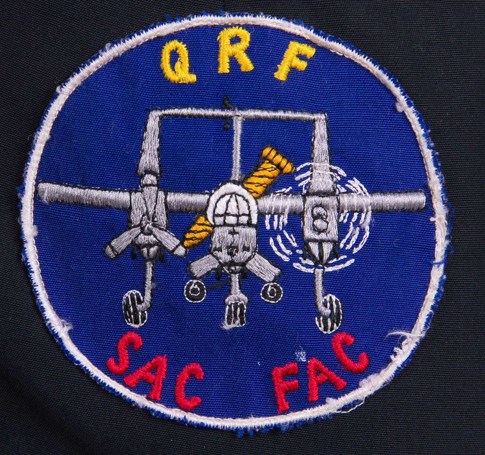 """The 23rd TASS QRF patch is a mystery. QRF could stand for """"Quick Return Flight,"""" hence the motionless propeller as after a technical problem. Yet it might also be """"Quick Reaction Flight,"""" with one engine running on alert, waiting to get the word to crank up. As for the SAC FAC, it could refer to B52 BDA missions performed by the FACs or to a former tanker/bomber pilot converted to the FAC role, which was not uncommon by then. Unfortunately, the pilot's listing of service received was incomplete."""