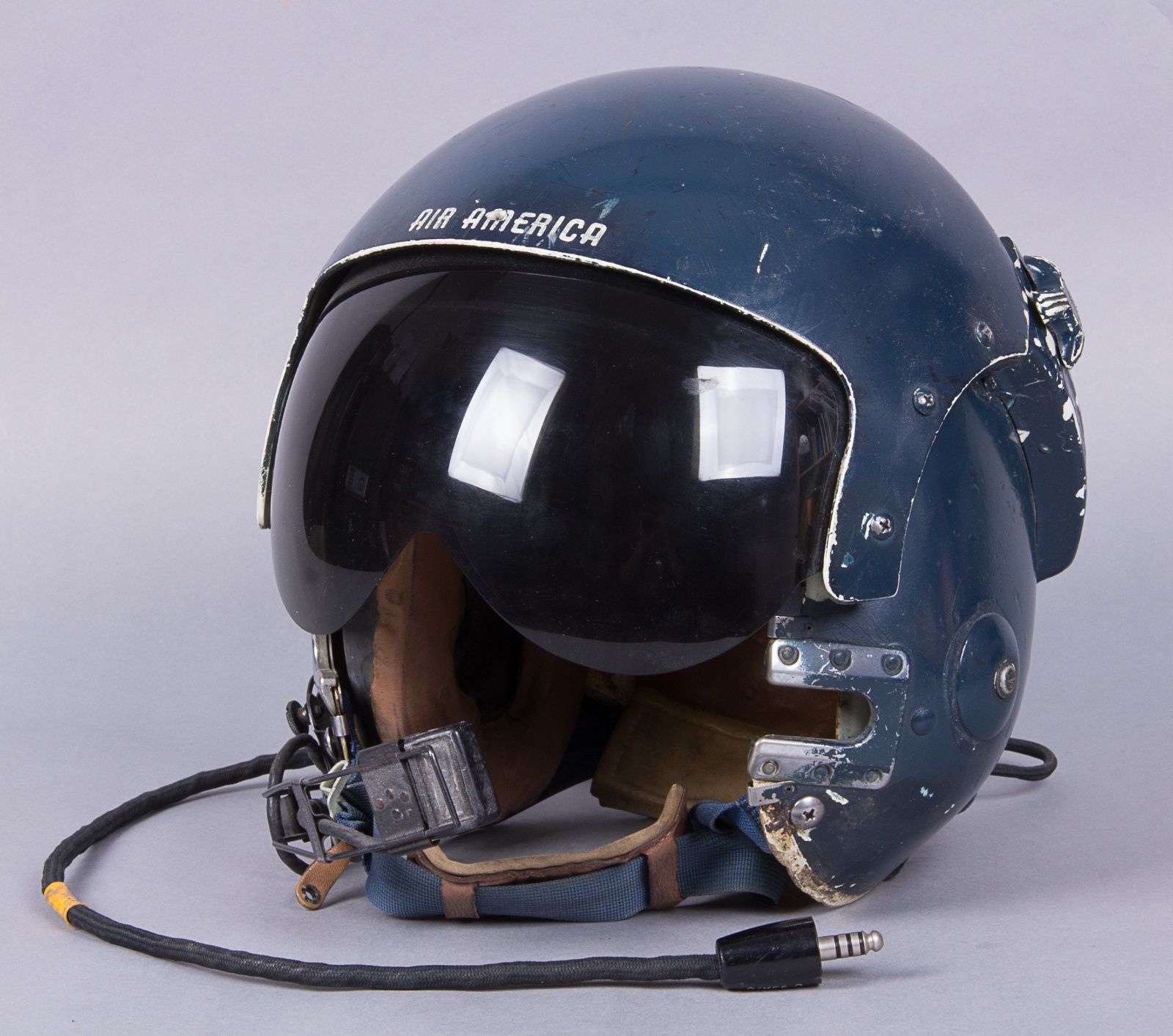This APH-6 flight helmet in our collection was worn by another Air America Huey pilot on that fateful day. Lyle D. Genz took off from the ICCS ramp on 29 April 1975, as rockets and mortar round hit the facility.
