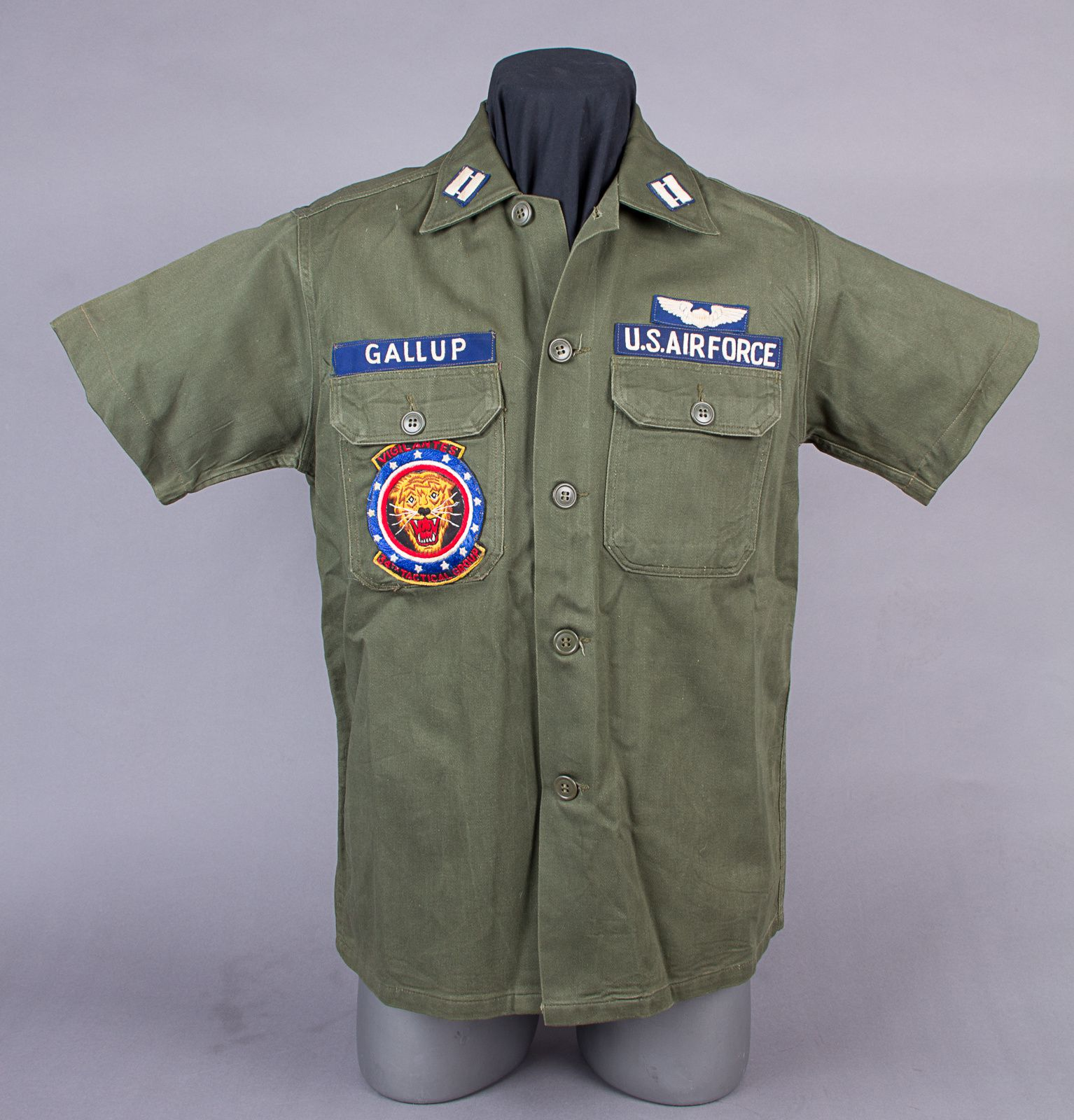 Capt. Gallup's second pattern OG-107 shirt, with the usual shortened sleeves. All patches, including the 34th Tactical Group pocket patch, are Vietnamese hand embroidered.
