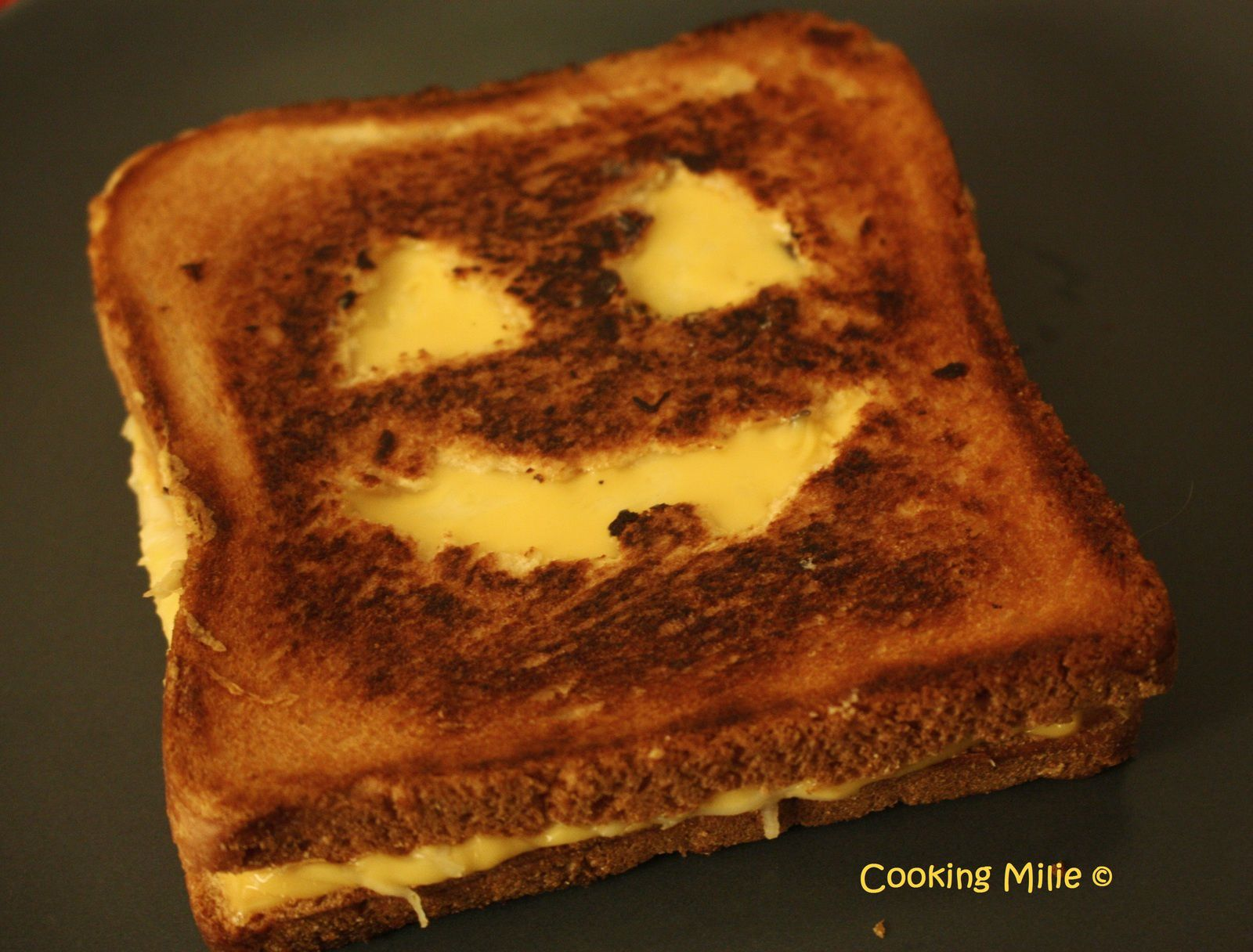 Halloween #19 - Jack O Lantern grilled cheese