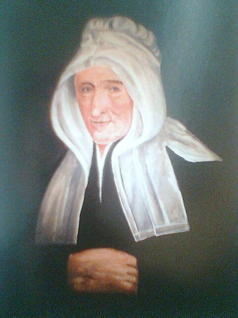 Honnezh a oa gwreg ur c'henwerzhour lin pinvidik a Gintin. An noblañs bihan a Vreizh he doa dalc'het d'ar gizioù broadel. Kavet e vez an daolenn-mañ e mirdi Sant-Teliav (Pentevr) / Ce tableau se trouve au musée de la toile de Saint-Thélo, en Penthièvre, pays qui succède à la Cornouaille orientale. Il représente l'épouse d'un riche négociant en toile de Quintin, aux environs de 1750 semble-t-il. La petite noblesse avait conservé les modes nationales.