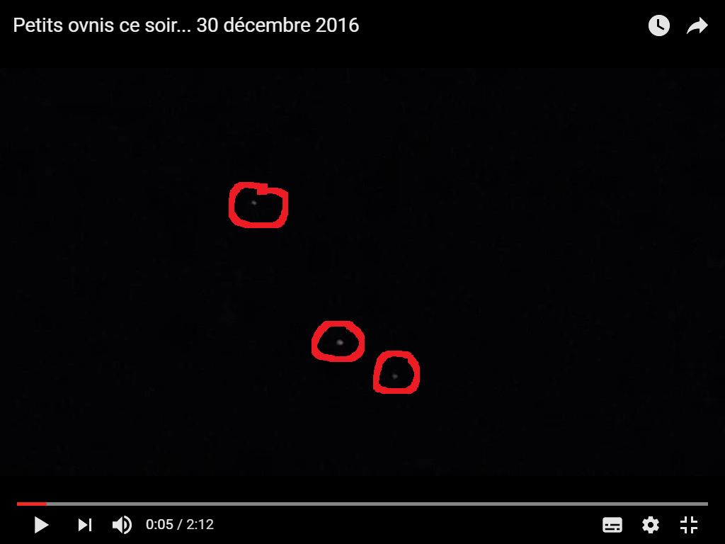 Crédit video Aurelia Petri. J'ai extrait cette image de la vidéo, et entouré en rouge ces ovnis. Près de Olloix, dans le Puy-de-Dôme, en Auvergne, en France...