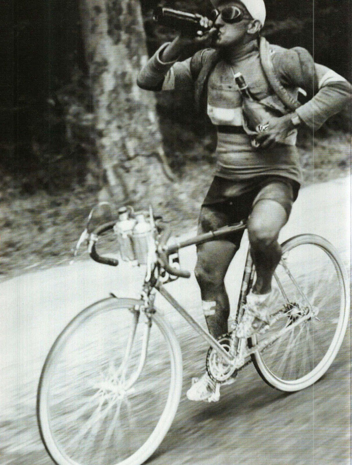 Jules Merviel from France having a drink during 1930 Tour.