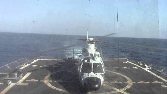 Chinese Harbin Z-9E helicopter practices landing aboard the U.S. Navy's  USS Sterett
