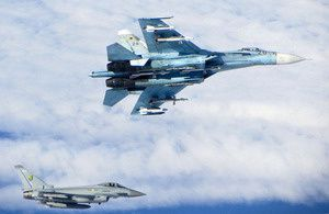 A Russian SU-27 Flanker (top) with a RAF Typhoon fighter - photo UK MoD