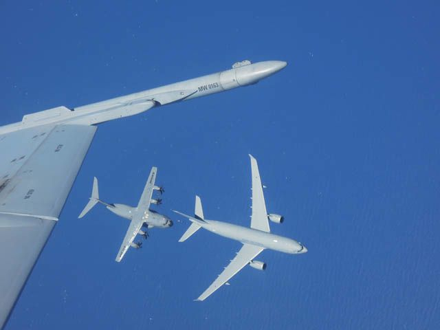 An Airbus A330 MRTT tanker aircraft refuels an Airbus A400M - photo Airbus DS