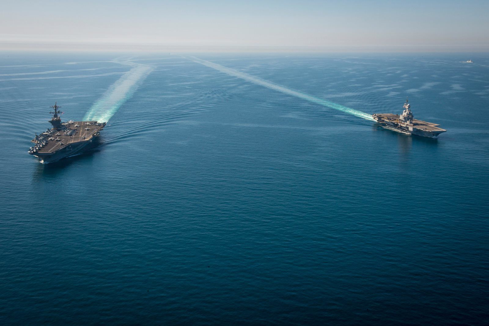Aircraft carrier USS Carl Vinson and French nuclear aircraft carrier Charles de Gaulle transit the Northern Arabian Gulf