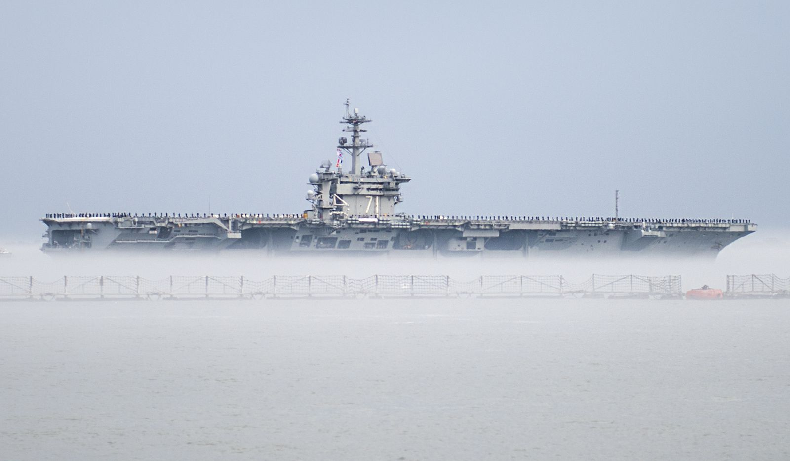 The aircraft carrier USS Theodore Roosevelt (CVN 71) departs Naval Station Norfolk for a scheduled deployment
