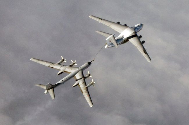 a Russian Tu-95 strategic bomber getting fuel from a Il-78 tanker aircraft. (Photo Norwegian Defense)