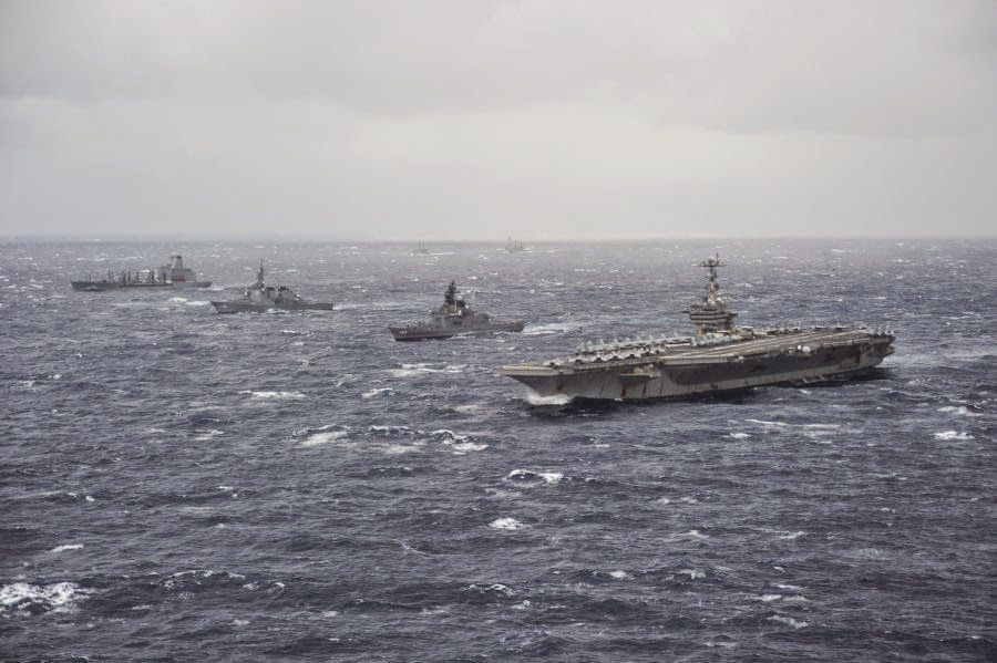 The aircraft carrier USS George Washington (CVN 73), right, the George Washington Strike Group and Japan Maritime Self-Defense Force ships.