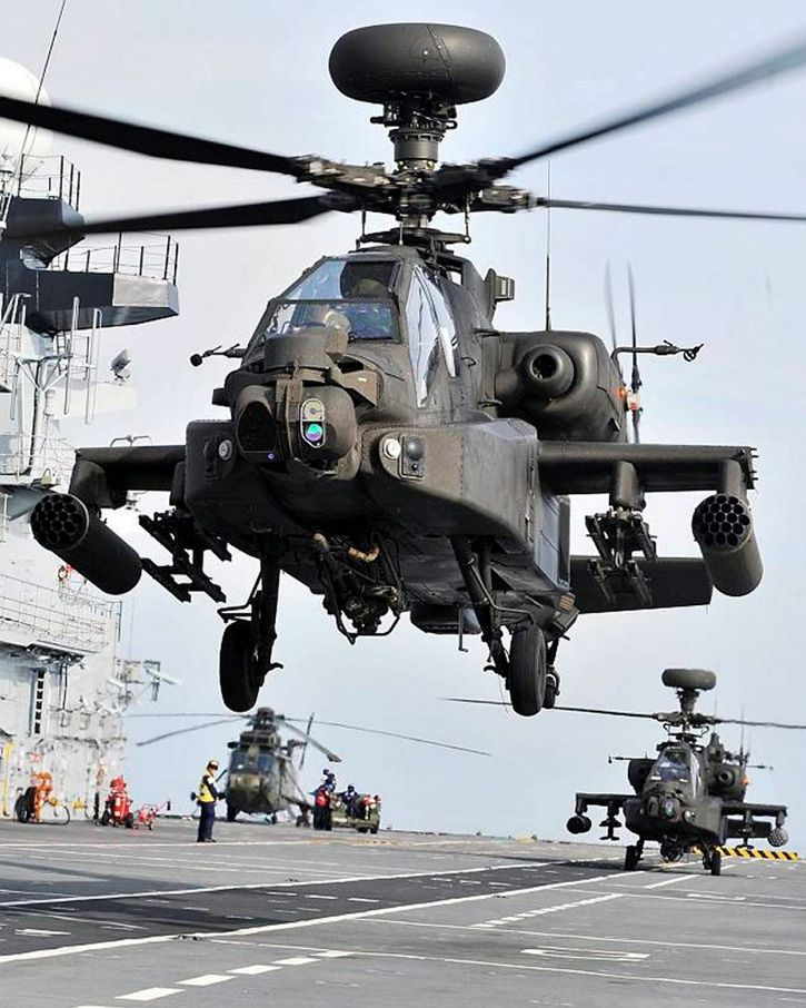 Two Apache helicopters from 664 Squadron, Army Air Corps, perform landing practice onboard HMS Illustrious. Photo Dean Nixon UK MoD