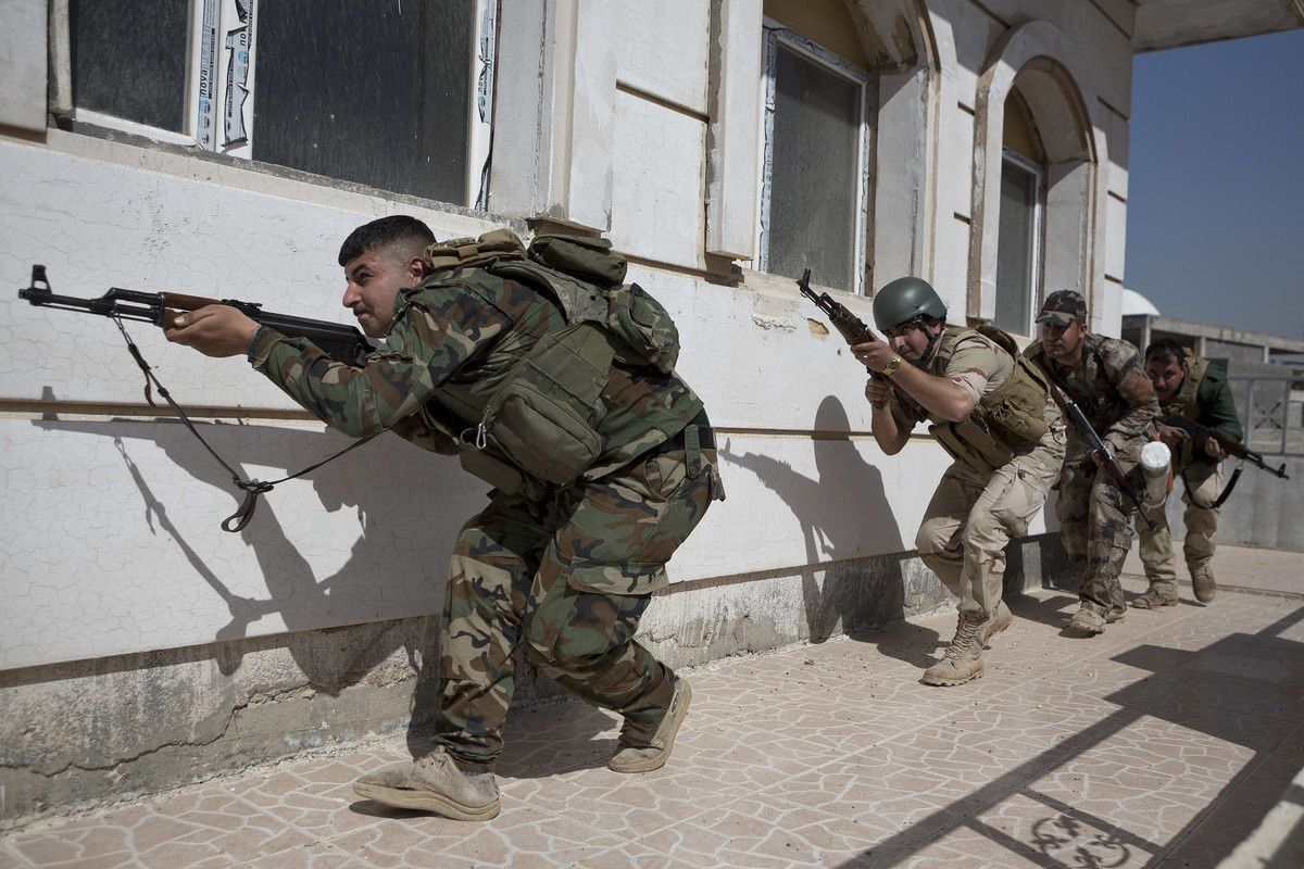 Peshmerga fighters during a simulated raid on a building -  photo Matt Cetti-Roberts
