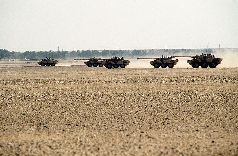 French AMX-10RC reconnaissance vehicles move across the desert as part of a display of Allied armor during Operation Desert Shield. - photo US DoD