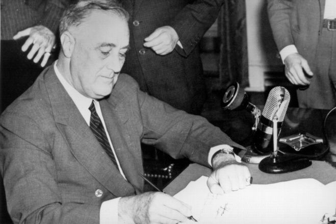 President Roosevelt signs the Selective Service Training and Service Act on Sept. 16, 1940, establishing the first peacetime draft and creating the Selective Service System