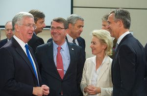 Defence Secretary Michael Fallon, left, attends the NATO Defence Ministerial in Brussels. Picture: NATO