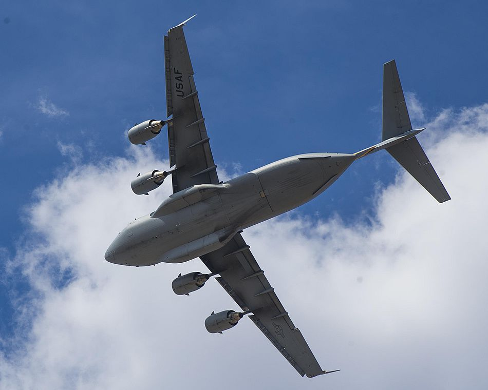 A C-17 Globemaster III flies over Biggs Army Airfield, Texas, during Bold Quest 15-2 operations Oct. 2, 2015 - photo USAF