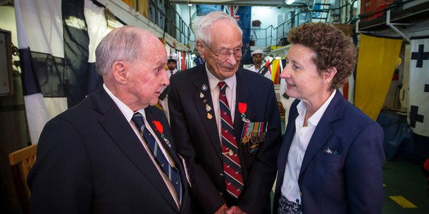 28.10.2015 Ronald Mayhill (left) and Basil Williams receive their medals yesterday from French Ambassador Florence Jeanblanc-Risler. Photo Jason Oxenham.jpg