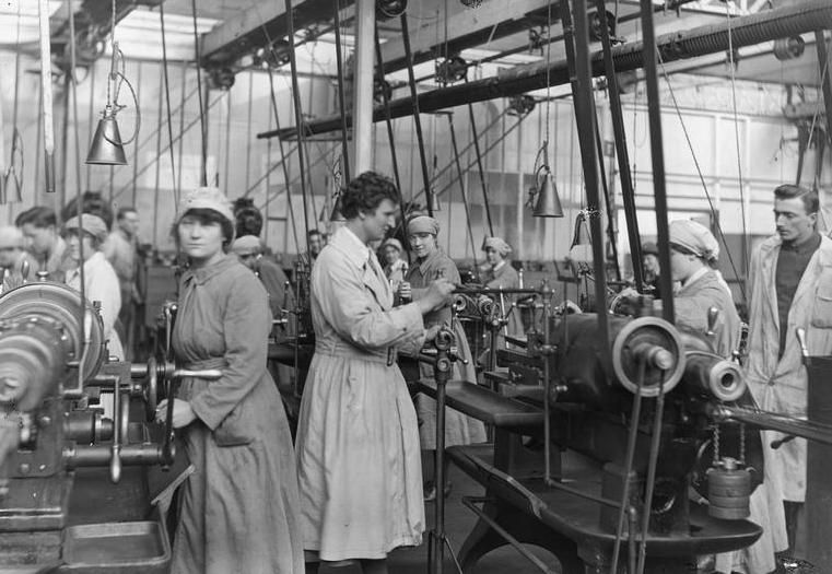 "Femmes travaillant à la chaine de réparation des moteurs d'avions dans l'usine des Fils de Georges Prieur, Les Damps, 1919. Engine Repair Shops, RAF. The QMAAC working in machine shop. Pont-de-l'Arche. Olive Edis &#x3B; IWM photographer of the women's services in France 1919, part of ""First world war official collection"" (photographs) Made by: Edis, Olive 1919. http://www.iwm.org.uk/collections/item/object/205244004"