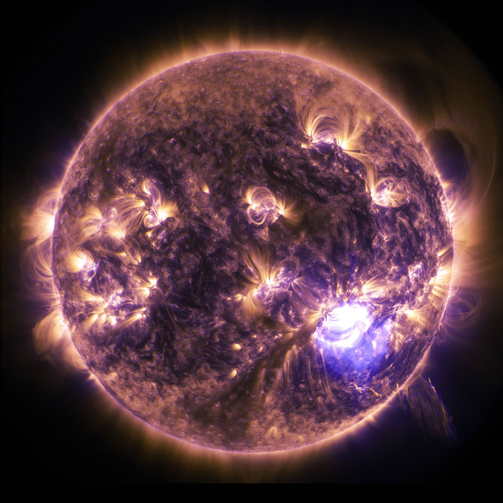 NASA's Solar Dynamics Observatory captured this image of a significant solar flare – as seen in the bright flash on the right – on Dec. 19, 2014. The image shows a subset of extreme ultraviolet light that highlights the extremely hot material in flares. Image Credit: NASA/SDO