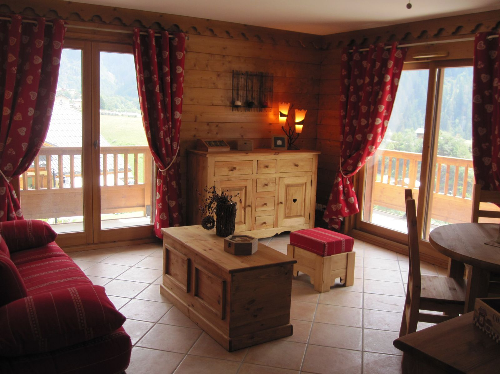 Our holiday accommodation is located in the typical resort of Champagny en Vanoise, in Savoie, not far from Courchevel, in the famous ski resort of La Plagne Paradiski. It is located at 1250 m of altitude, at 500 m far from the centre of the resort and the ski lifts (shuttle bus free). It is a small building divided into several accommodations. This one is located on the third floor. Interior It is very comfortably furnished in a contemporary style. You will have a living room with a double sofa bed, an open kitchen, a bedroom with a double bed, a bedroom with two single beds, a shower room, a bathroom and a WC. Exterior Outside, you will find a terrace with garden furniture and a parking space. An excellent choice to discover the park of the Vanoise The residence also includes a fitness centre, a Turkish bath, a sauna and a swimming pool. These facilities are available from mid-December to mid-April as well as in July and Augustus.