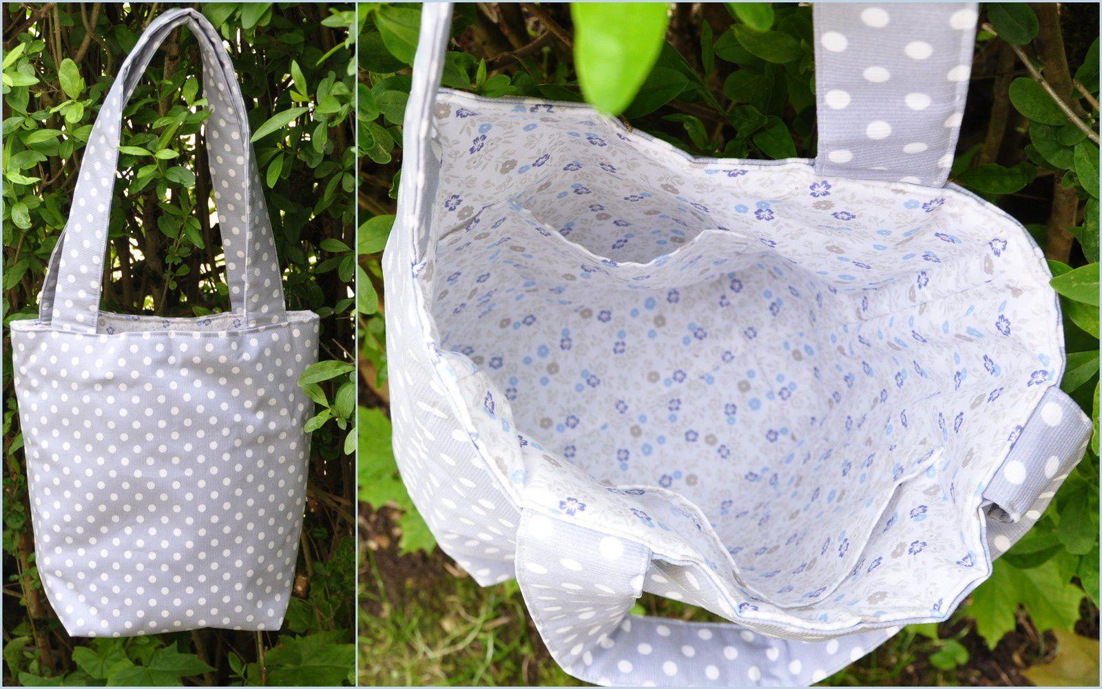 VENDU  Sac tissu ciré gris/pois blancs . Coton blanc à fleurs bleues et grises à l'intérieur . 2 poches . 27cm haut X 18cm X 11cm . Anses 30cm .    25.00€