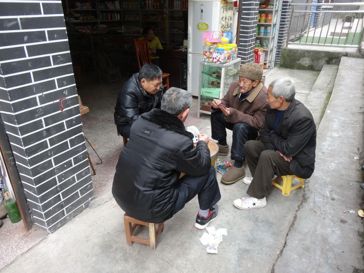 Les joueurs de carte dans la rue