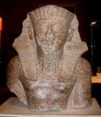 the face of this statue show signs of attack, look how they took off it's nose/mutilate the face, but the native African(Black) origin of this pharaoh is still there.