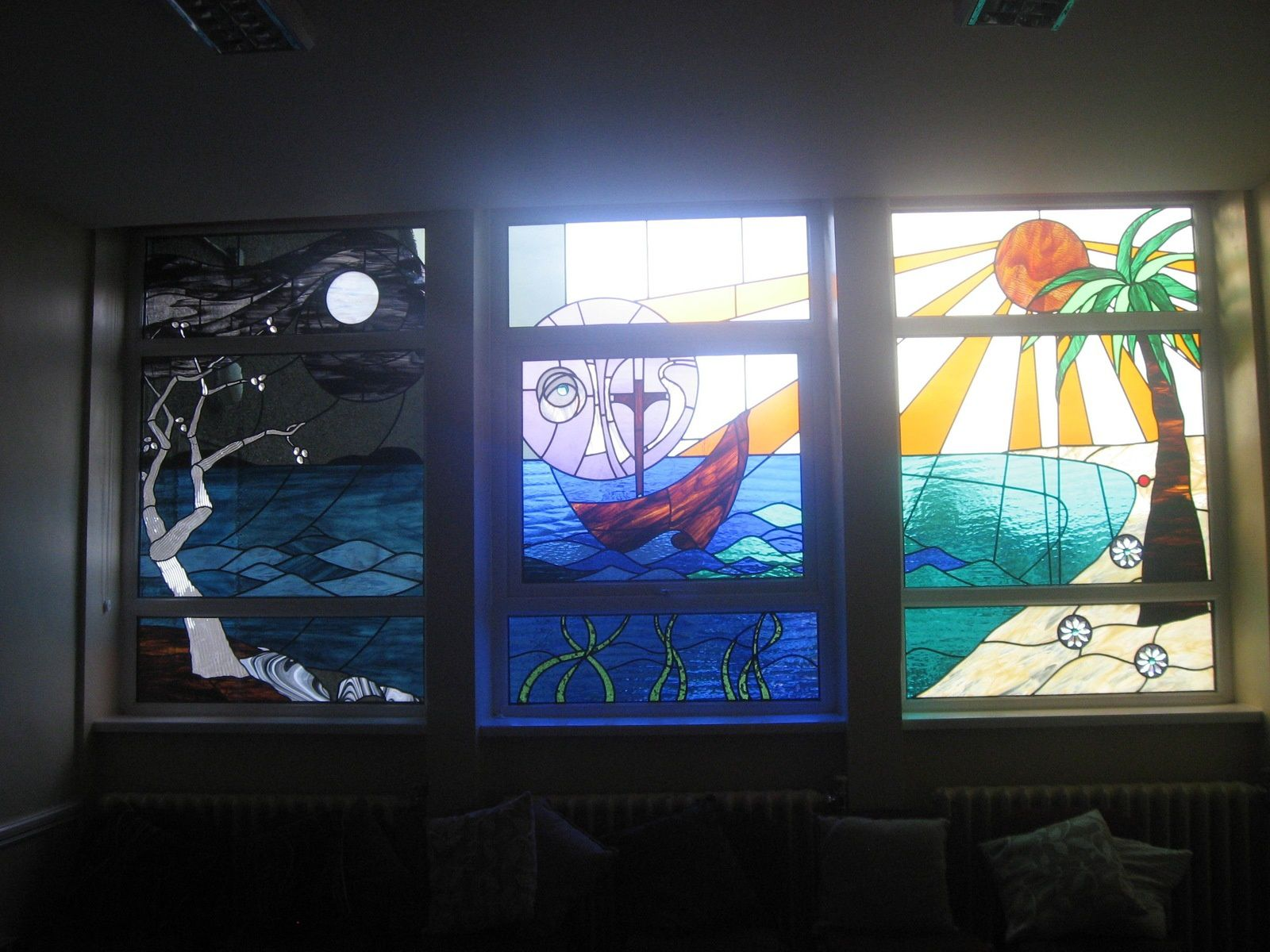 The three panels of the stained glass windows