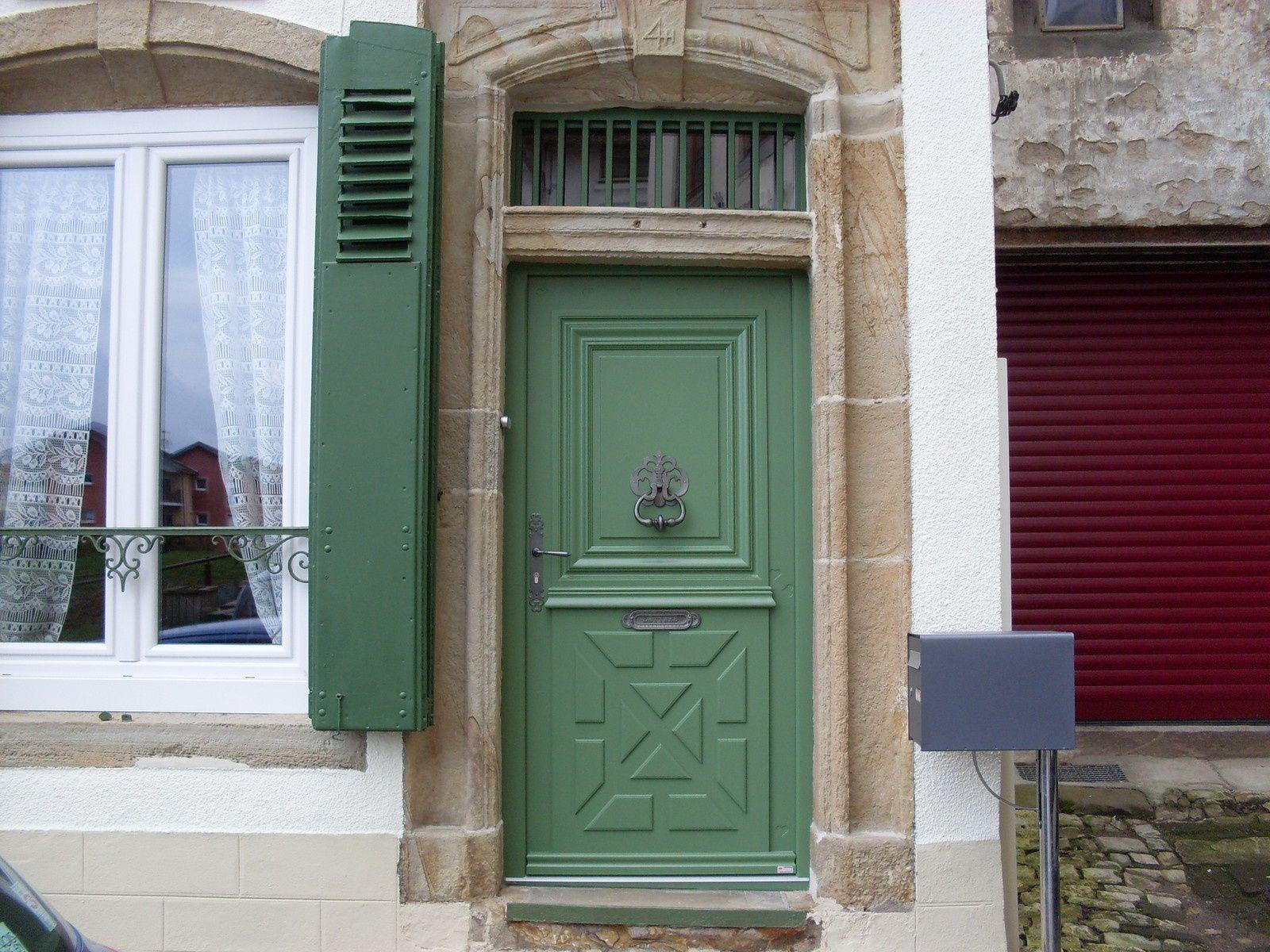 Porte d 39 entree bois ma menuiserie for Joint de porte d entree