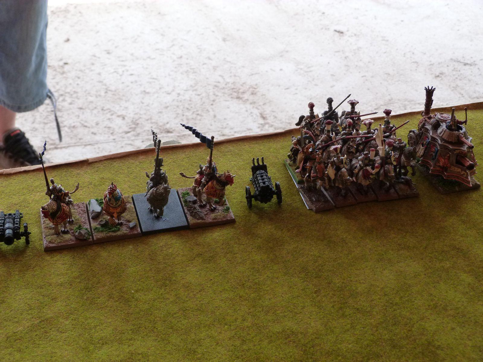 ... Un canon, une autre unité de 4 chevaliers demi-griffon, un feu d'enfer, 10 chevaliers du cercle intérieur avec le sorcier de niveau 4, le général et un prêtre guerrier et un tank à vapeur !