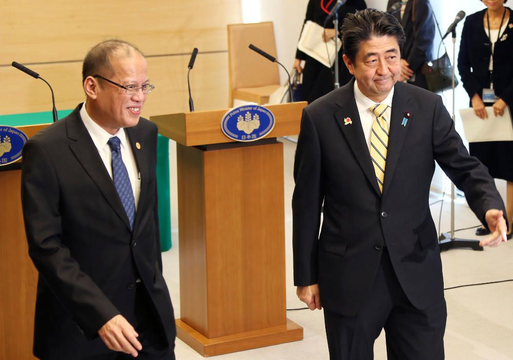 Japan, Philippines collaborate: Philippines President Benigno Aquino III and Japanese Prime Minister Shinzo Abe leave a joint news conference at Abe's official resident in Tokyo a day before the ASEAN-Japan Commemorative Summit. [AFP]