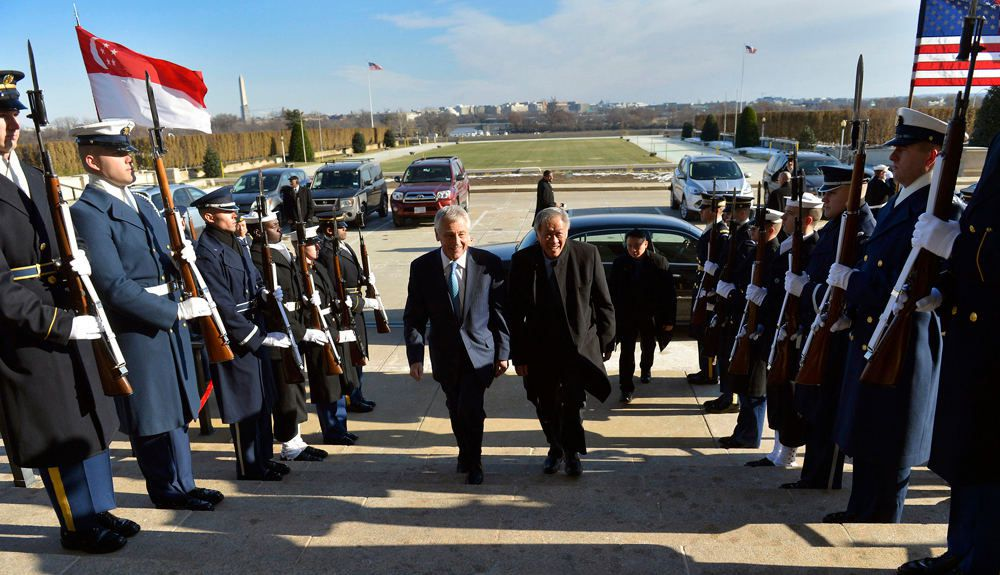 Visiting Washington: U.S. Defense Secretary Chuck Hagel welcomes Singapore Defense Minister Ng Eng Hen to the Pentagon in December. [Glenn Fawcett/Department of Defense]